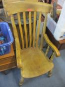 An early 20th century beech lathe back armchair with a moulded seat 108cm h x 53cm w