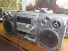 An Aiwa CD/tape player with two speakers
