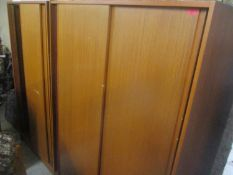 A pair of mid 20th century retro teak wardrobes, 174h x 121cm w