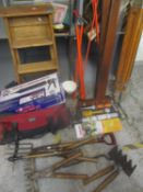 A mixed lot to include a vintage folding ladder, garden tools, boxed pointing and grouting gun kit
