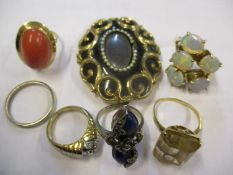 Yellow metal rings to include a silver gilt and five opal style ring, 5.1g together with a yellow