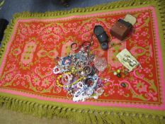 A Retro Casa Pupa style pink ground rug together with costume jewellery, an Oris watch, mother of