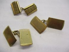 A pair of 9ct gold chain and tablet cufflinks