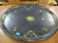 A Victorian black papermache tray with mother of pearl inlay and a central motif depicting a young