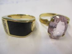 A gents 14ct, black stone and diamond chip ring, 5.1g together with a yellow metal and pink sapphire