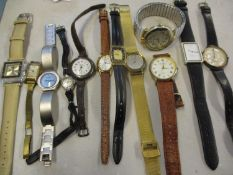 A group of wristwatches to include Rotary, Seiko, Swarovski and a yellow metal part cased ladies