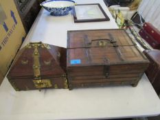 Two wooden middle Eastern/North African boxes, one with applied brass work, lock and carrying handle
