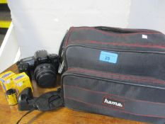 A Canon EOS, 1000F, camera with a Sigma lens, a travel bag and accessories