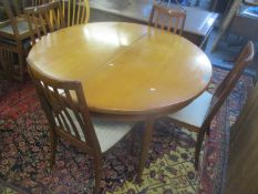 A mid 20th century G-Plan teak extending dining table 73cm h x 122cm w, and four dining chairs