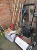 A quantity of garden tools to include post hole digger, electrical strimmer, Eckman push mower