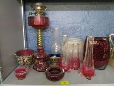 A selection of Victorian and later glassware to include a brass and cranberry glass oil lamp and