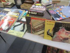 A vintage trunk together with compilation cd's and mixed records 1960's-1980's to include The