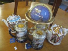 A desk top globe inset with semi-precious stones, two Franklin Mint tankards and two Sadler teapots