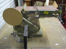 "A Nutool 4"" belt and disc sander mounted on a table"