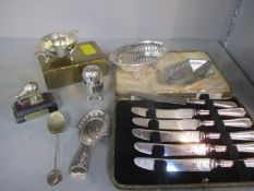 Silver handled butter knives, two silver baskets (95.2g), a cigarette box and a mounted model of New