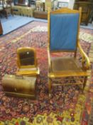 An Edwardian mahogany framed rocking chair, a Victorian dressing mirror and a cased Singer sewing
