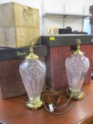 A pair of Waterford cut crystal glass and brass table lamps together with two Harrods hamper boxes