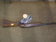 A BSA .22 air rifle together with a Bisley and a Nikko sterling telescopic sights and a tin of