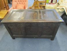 A Georgian oak carved coffer tri-panelled front with lock on stile feet 62 x 119 x 56.5cm, circa