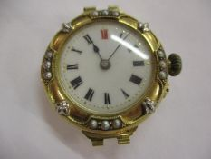 An early 20th century 18ct gold and seed pearl ladies watch, 17.3grams, deficient of strap