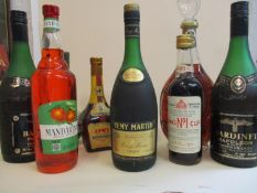 A selection of mixed bottled spirits to include Remy Martin cognac, 24 fl oz