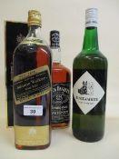Four bottles of Whiskey to include Jack Daniels, Black & White Johnnie Walker