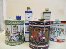 Five ceramic flasks to include Grenadier Guards and miscellaneous stoppers, drum, Napoleon Drum