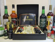 A Guinness presentation case with Toucan Inn Visitor glass and two bottles of Guinness and mixed
