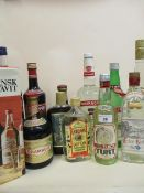 Twelve mixed bottles of spirits to include Gordons dry gin, Kirsch, Drambuie etc