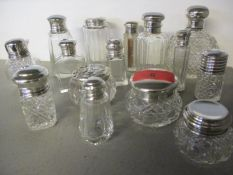 A collection of silver and silver plated topped cut glass dressing table pots (16)