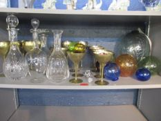A selection of glass witches balls/sea balls, decanters and stoppers, a French art nouveau enamelled