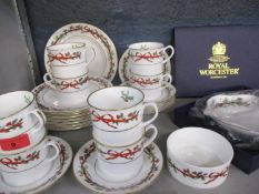 A Royal Worcester Christmas set comprising eight cups and saucers, eight tea plates, a sugar bowl