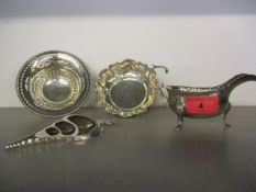 An Alex Clark & Co silver dish on cabriole legs, a silver sauce boat, a pierced silver dish and a