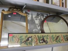 An oval mahogany wall mirror, a reproduction French style and gold painted mirror, a Thai screen