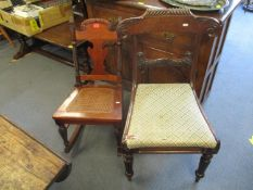 A Victorian mahogany cane seated rocking chair with pineapple finials, and a William IV rosewood bar