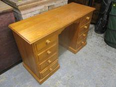 A modern pine eight drawer twin pedestal desk 74h x 141cm w