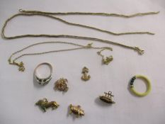 A 9ct gold chain (1g), another 9ct gold chain A/F (5.7g), together with an ivory , malachite and