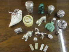 A collection of small silver and white metal items, mainly ornaments, to include a Country Artists