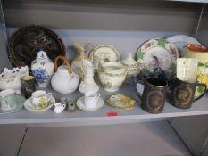 A Belleek black stamp jug, two Wedgwood black basalt commemorative tankards, a studio pottery