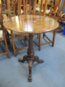 A Victorian mahogany pedestal occasional table, circular top, supported on turned and tapering