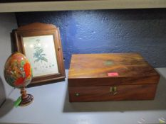 A mahogany writing box with fitted interior, a key box with a flora botanica inset print to the lid,