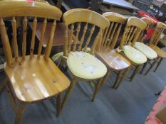 A matched set of six modern pine kitchen chairs with three loose cushions