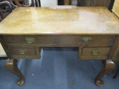 A Georgian oak desk having two long drawers above two short drawers on cabriole legs 78 h x 107 w