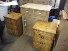 A stripped pine side unit having two small drawers above one cupboard door and three ceramic bun