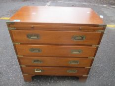 A 20th century Campaign style mahogany chest with four drawers and a slide, on bracket feet, 64 h x