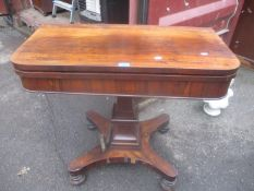 A William IV rosewood foldover card table on a quatrefoil base with turned feet 78cm h x 90.5cm w