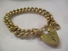 A 9ct gold bracelet having a heart shaped locket, 13g