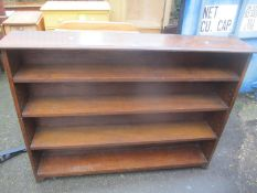 A 1930's oak four tier bookcase 107 h x 142cm w