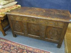 Circa 1650's, a carved oak and tri-panelled coffer with candle box incorporated, 53cm x 110cm x 51cm