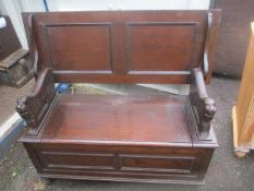 A mid20th century oak monks bench with a hinge top seat and lion handles, on turned feet, 93 h x